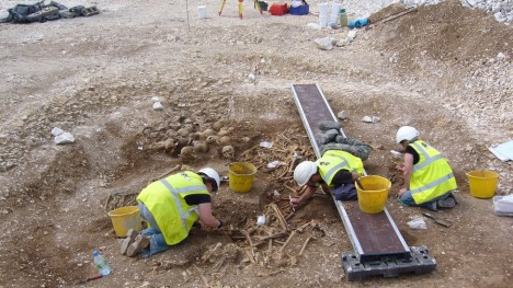 _73388379_excavating_mass_grave3_(1)