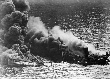 A tanker sinking off the Outer Banks after being hit by a U-boat.