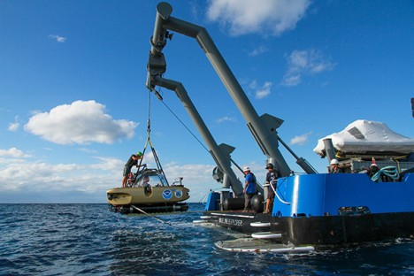 The manned submersible is being lifted out of water after its dive to the U-576 and Bluefields wreck sites.