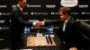 Carlsen impresiona y Caruana resiste en la primera partida del Mundial