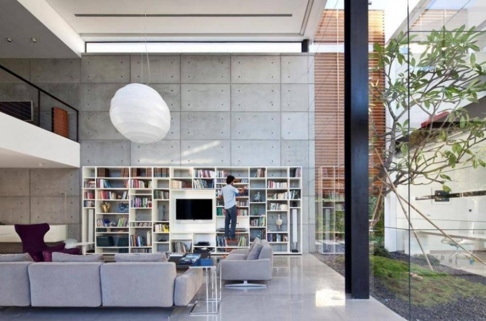 floating-paper-lantern-in-home-library-with-exposed-cement-wall-interior-accent
