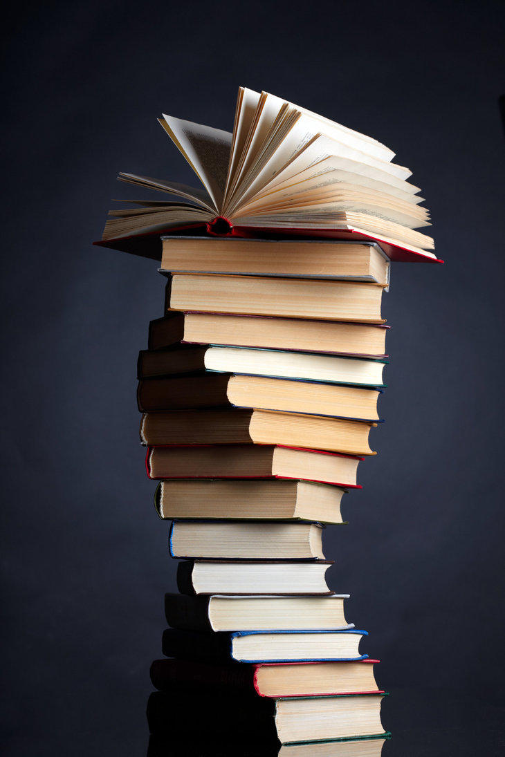 pile_of_books_on_a_black_background_by_macinivnw-d68c8a1