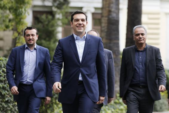 Greece's newly-appointed PM Tsipras leaves the Presidential Mansion after his swearing-in ceremony as Greece's first leftist prime minister in Athens
