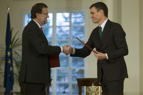 Spain's PM Rajoy shakes hands with Sanchez, leader of the Spanish Socialist Workers' party in Madrid