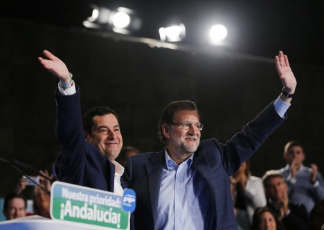 Spain PM Rajoy and Andalusian regional People's Party (PP) leader and candidate for the region's elections, Moreno Bonilla wave during a party meeting in Seville