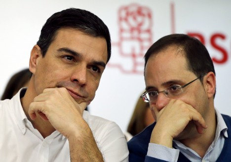 Spain's Socialist Party (PSOE) leader Pedro Sanchez listens to party member Cesar Luena during the party's federal committee meeting at their headquarters in Madrid, Spain