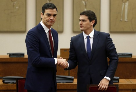 Socialists' (PSOE) party leader Pedro Sanchez and Ciudadanos party leader Albert Rivera shake hands after signing an agreement in Madrid