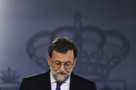 Spain's acting PM Rajoy attends a news conference at Moncloa Palace in Madrid